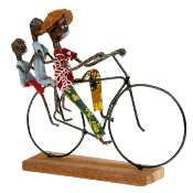 Model bike, cyclist x 3 with bag, wooden base