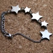 Bracelet silver coloured 5 stars