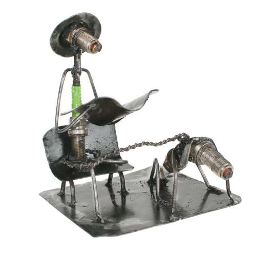 Model made from spark plugs, man with dog