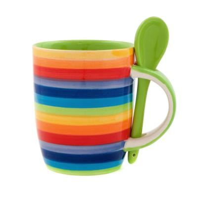Rainbow mug and green spoon **