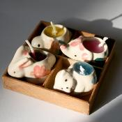 Pack of 4 mini candles in animal holders