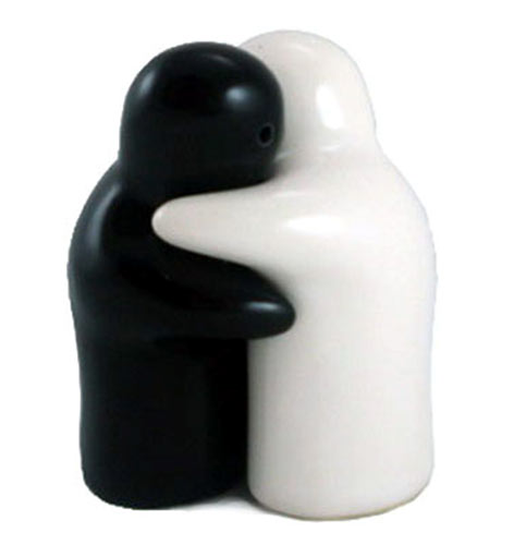 Salt and pepper pots hugging black and white **