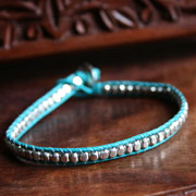 Bracelet blue cord silver colour beads