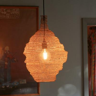 Wire lampshade with gold coloured rings