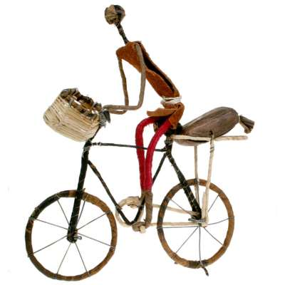 Model bike, cyclist with bag and basket